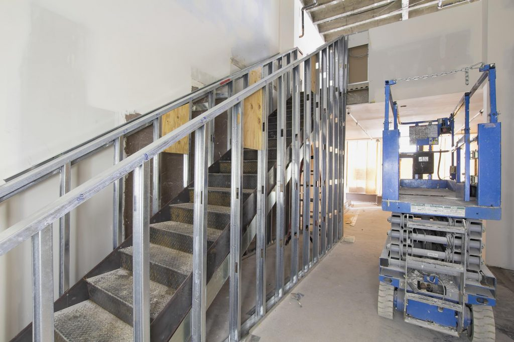 under construction house with metal stair and handrails